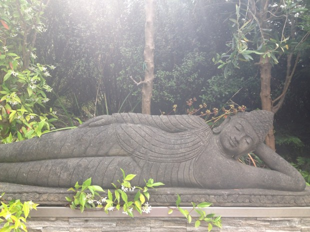 Reclining Buddha enjoying the scent of jasmine.
